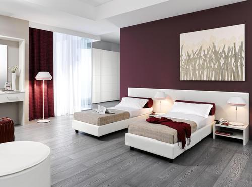 Letti moderni ferro battuto le fablier piombini for Camere da letto hotel moderni